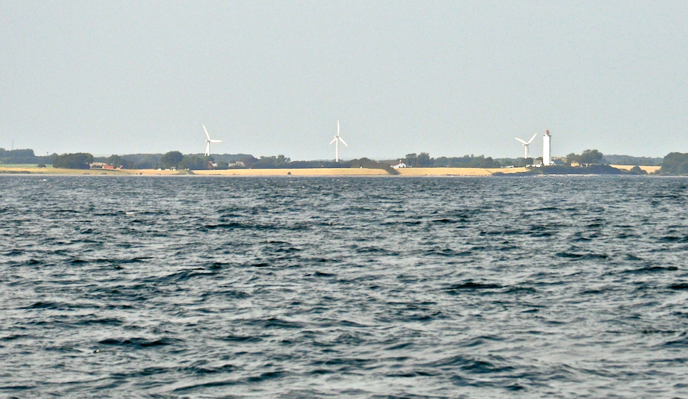 A view of the Danish island of Langeland. Wind generators are everywhere in Denmark | Cruising Attitude Sailing Blog - Discovery 55