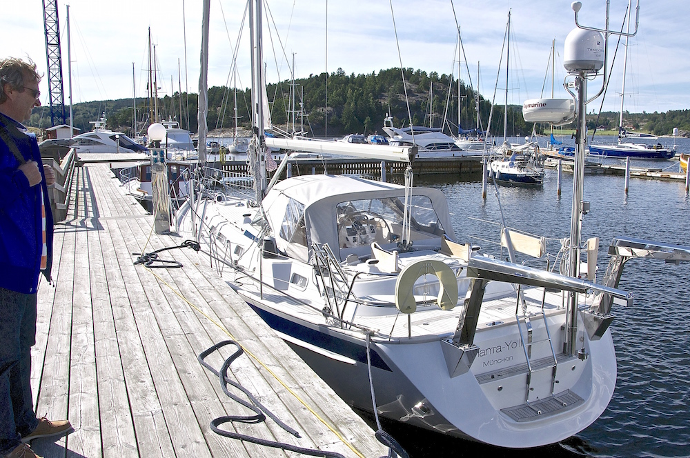 The search for out dream boat begins. Jacques inspecting a Hallberg-Rassy 53 at Vindö Marina on the west coast of Sweden. | Cruising Attitude Sailing Blog - Discovery 55