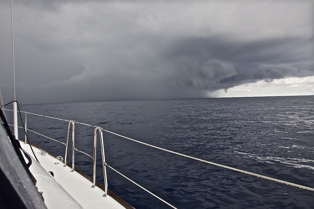 Squall between the islands of Minorca and Mallorca. Cruising Attitude Sailing Blog - Discovery 55