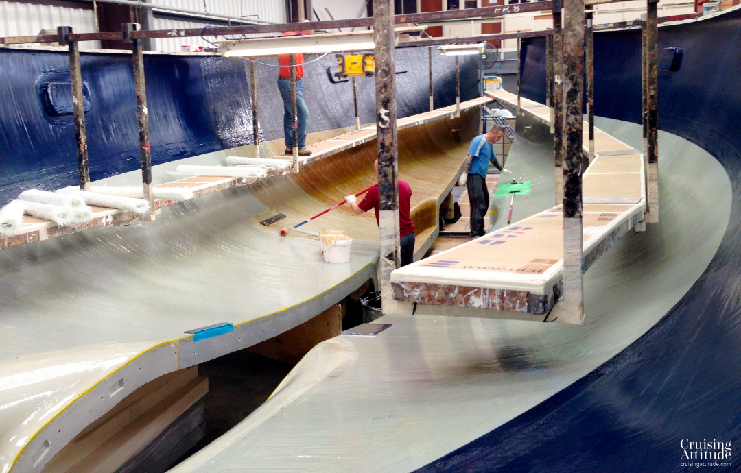 Fibreglass layers going into the mould | Cruising Attitude Sailing Blog - Discovery 55