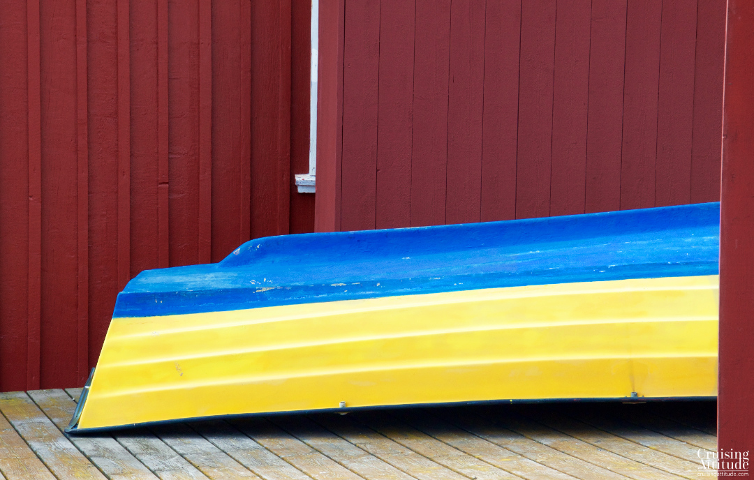 A rowboat in swedish colours; Mollösund, Sweden | Cruising Attitude Sailing Blog - Discovery 55